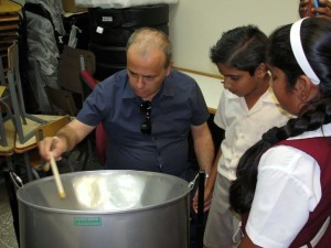 Ali being introduced to the steelpan during visit to school in Victoria District